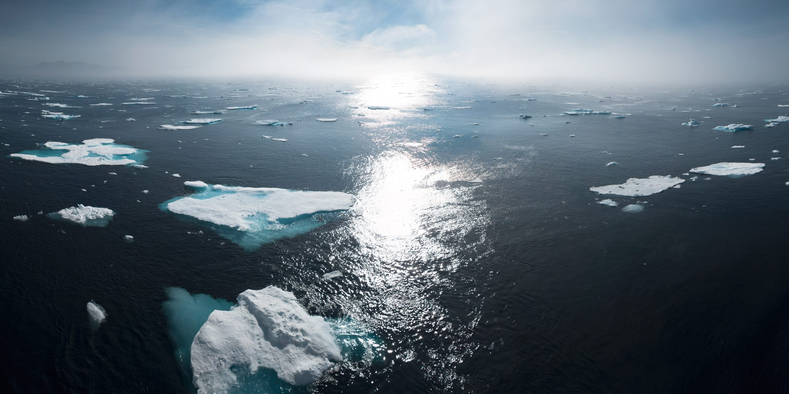 landscape and aerial photography of icebergs on body of water during daytime
